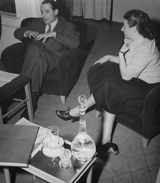 "Ettore Sottsass (architect and designer) and Germana Marucelli during a ""Thursday Rendez-Vous"" at Marucelli's atelier in via Cerva 38/2, Milan, 1949 © Patellani 