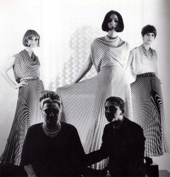 Germana Marucelli and Getulio Alviani with models (centre: Lillina Monti; right: Franca Serpagli) during the presentation of Linea Optical (Spring/Summer 1965) at Marucelli's Milan atelier, March 1965. Photo by Ada Ardessi © Isisuf Milano | Archivio Germana Marucelli